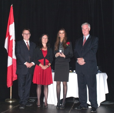 From left to right: Bruno Morin – Chairperson, FITT Board of Directors; Caroline Topkins, President, FITT; Esha Abrol; Peter McGovern, Canada's Chief Trade Commissioner, DFAIT
